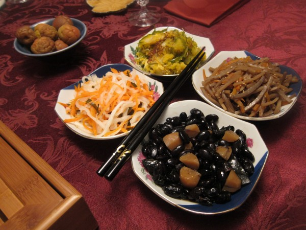 "More side dishes. ""Red and White"" carrot and daikon (salted and seasoned with sweet rice vinegar), abalone salad with tobiko, burdock root and carrot kimpira, and black beans."