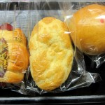 chicken bun, spicy sausage roll, and pineapple bread from UCafe