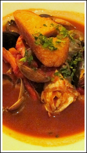 Cioppino ($27) -- dungeness crab, rock fish, mussels and clams in red wine tomato sauce. Good but too spicy for me.