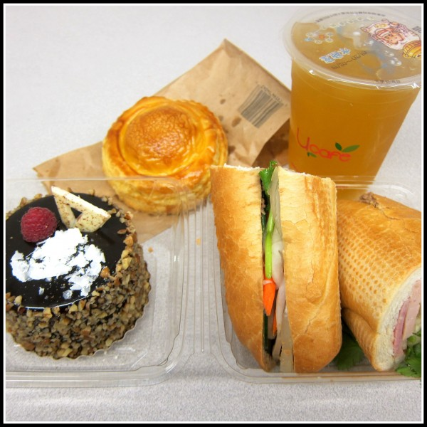 Clockwise from top left: patechaud (brioche with minced pork, $1.50), mini chocolate mousse ($3.95), cold cut banh mi ($3.25), lychee green tea (with lychee jelly, $3.50)