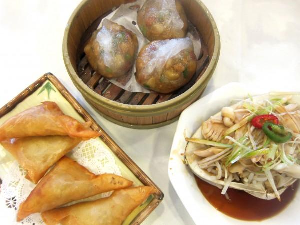 Clockwise from top: Chiu Zhou dumpling ($3.95), steamed clam ($6.95), curry chicken samosas ($3.25)
