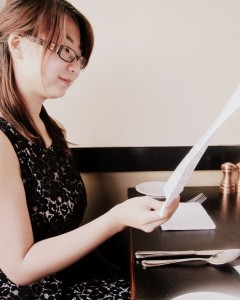 Kristen studying Corso menu.