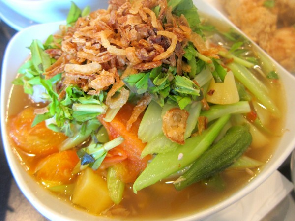 Canh chua - sour soup with fish, tomato, pineapple, okra and celery