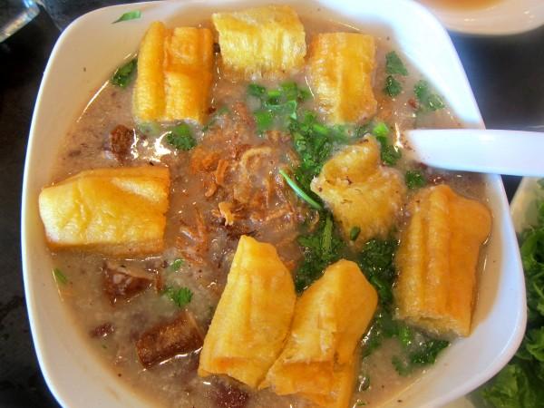 "Chao long - rice porridge with ""dau chao quay"" (youtiao) and pork offals."