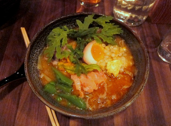 Hokkaido butter corn miso ramen with smoked king salmon, pork belly, soy-marinated egg, snap peas, chrysanthemum greens, and shiitake.