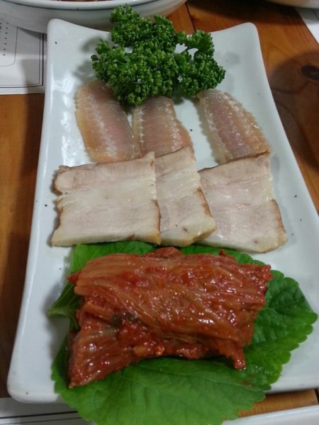 Fermented skate (홍어 hong uh) with pork belly (삼겹살 samgyeopsal)  and kimchi. I had no idea what this was at the time so I just ate it without any hesitation! A few of the other Korean graduate students from UC Berkeley told us that fermented skate is one of the dishes where your family either eats it or is repulsed by it. Since I was coming in with a clean slate, I have to say that it didn't taste so bad. I've never had fermented fish before and with the pork belly and super old kimchi, the taste isn't quite as strong as I would have though it to be. On its own though...it's not that bad either but the aftertaste becomes super pronounced. My mouth became numb (not in a bad way but like I ate an entire stick of mint candy) and that sensation of cooling numbness stuck in my mouth for a while. I definitely would eat it again!